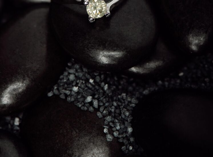 Yellow Diamond ring product shot on in black sand and stones